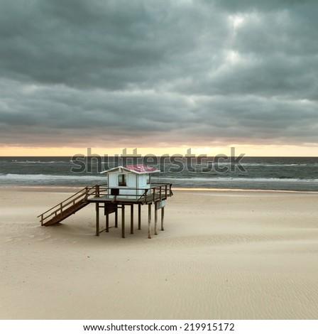 Lifeguard house on a sandy beach on sylt Island, germany - stock photo