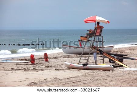 Lifeguard on duty near the Ocean - stock photo