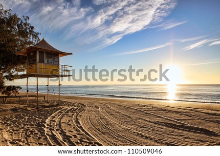 Lifeguard patrol tower on the beach at sunrise, Gold Coast, Australia - stock photo
