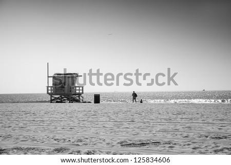 Lifeguard station and people nearby, Venice Beach, Santa Monica - stock photo
