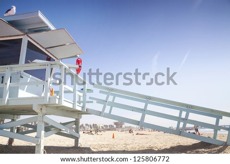 Lifeguard station and tanning and resting people behind, Venice Beach, Santa Monica - stock photo