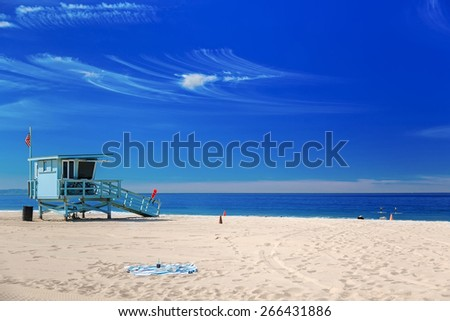 Lifeguard station with american flag on Hermosa beach, Californi - stock photo