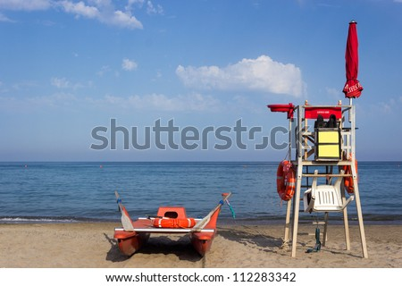 Lifeguard tower and boat, rear view - stock photo