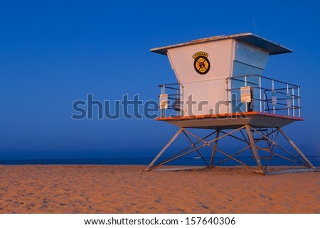 Lifeguard tower at Santa Cruz beach by night and blue sky - stock photo