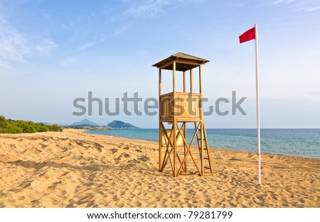 Lifeguard tower in the beach against blue sky in the afternoon - stock photo