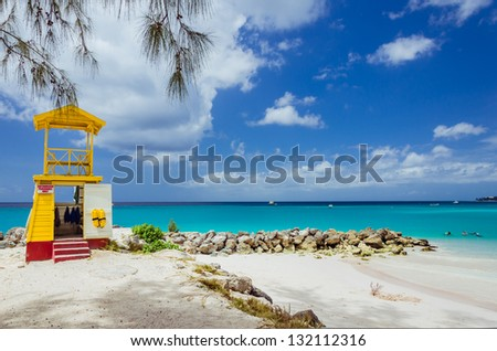 Lifeguard Tower on a Beach with Blue Sky and Turquoise Water - stock photo