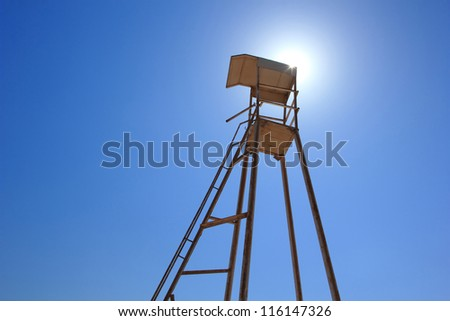 Lifeguard tower on a blue sky background - stock photo