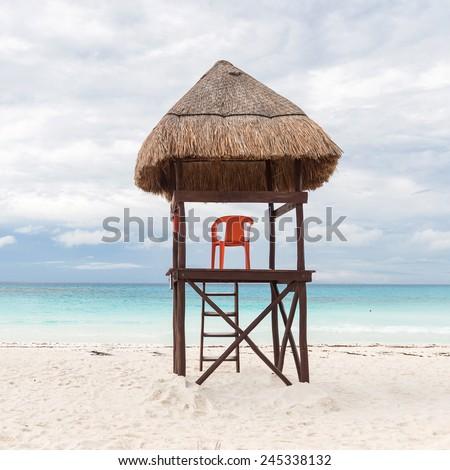 Lifeguard tower on caribbean beach - stock photo
