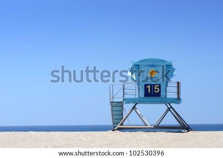 Lifeguard tower on open beach - stock photo