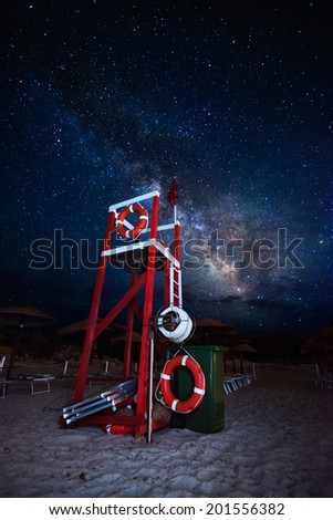 Lifeguard tower on the beach at night under the milky way - stock photo