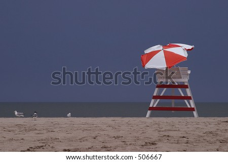 Lifeguard tower on the beach with gulls - stock photo