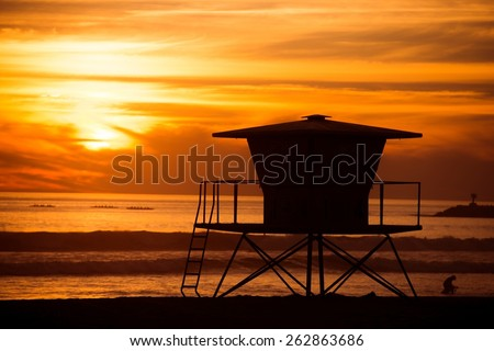 Lifeguard Tower Sunset Silhouette Scenery. California, Oceanside Beach at Sunset. - stock photo