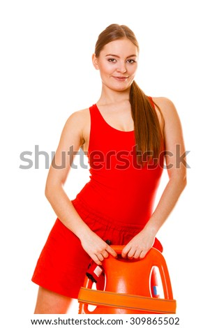 Lifeguard with rescue tube buoy. Woman supervising swimming pool water. Accident prevention. - stock photo