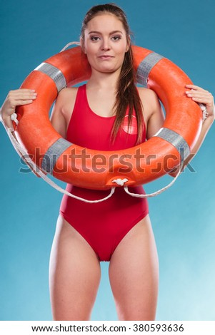 Lifeguard with ring buoy lifebuoy. Woman girl supervising swimming pool water on blue. Accident prevention rescue. - stock photo