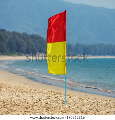 Lifesavers patrol red and yellow flag on the beach