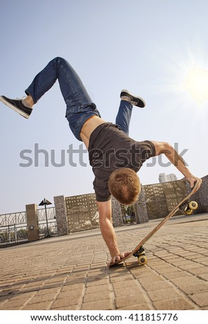 Lifesttyle photoshoot skateboard guy with practis boarding in the city - stock photo