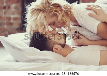 Lifestyle. Beautiful couple in bed - stock photo