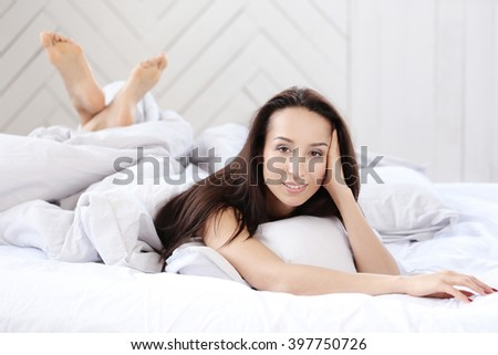 Lifestyle. Cute girl in the bed