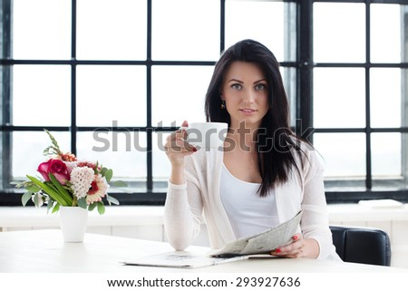 Lifestyle. Cute girl with cup of tea - stock photo