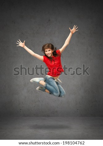 lifestyle, dancing and people concept - happy jumping teenage girl