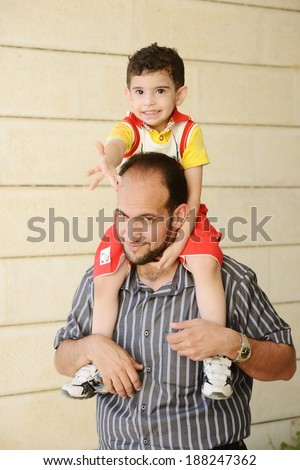 Lifestyle father parenting kids - stock photo