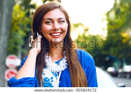 Lifestyle fresh portrait of young amazing smiling positive girl, long brunette fluffy hairs, fresh natural make up, stylish clothes and accessorizes , pure beauty. - stock photo