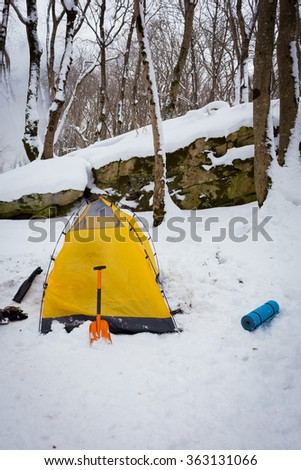 Lifestyle hiking. Tent Camping in the winter. - stock photo