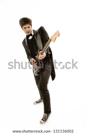 Lifestyle. male musician dressed in a frock coat with a guitar in his hand really wants to become a famous rock performer. Become a mega star known worldwide. virtuoso playing on Musical instruments - stock photo