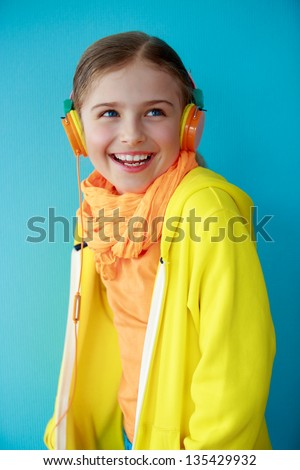 Lifestyle of young people concept - Young girl with headphones listening music, happy young girl. - stock photo