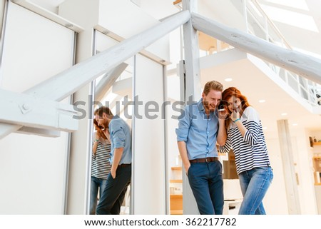 Lifestyle photo of couple in living room hugging and posing - stock photo