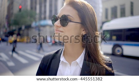 lifestyle portrait of attractive young women with sun glasses. happy smiling female model. urban city background - stock photo