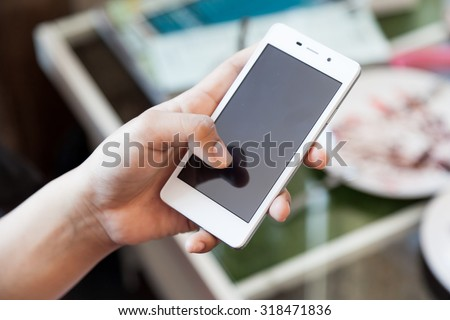 lifestyle young man using a mobile phone with texting message on app smartphone, playing social network and shopping online - stock photo