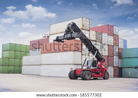 Lift crane at cargo yard - stock photo