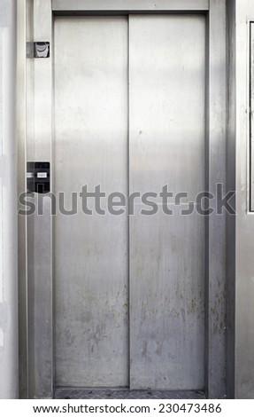 Lift metal door urban building, construction - stock photo