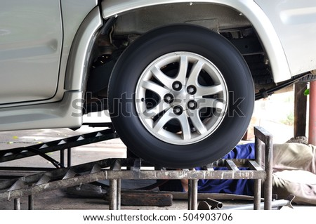 Lift up the truck for exhaust pipe maintenance.