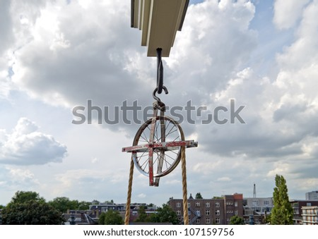 Lifting beam and wheel for moving furniture into or out of a tall house in Amsterdam. - stock photo