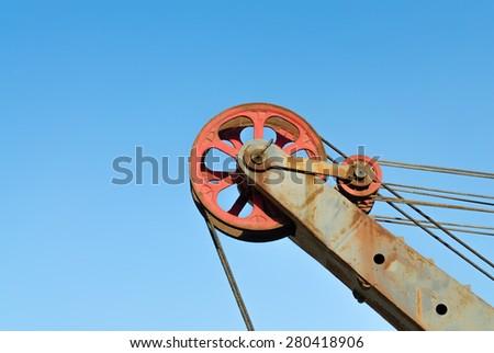 Lifting block of construction crane - stock photo