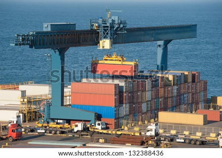lifting container in port - stock photo