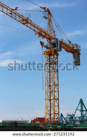 Lifting crane used at site of Concrete bridge across Chaophraya river under-construction - stock photo