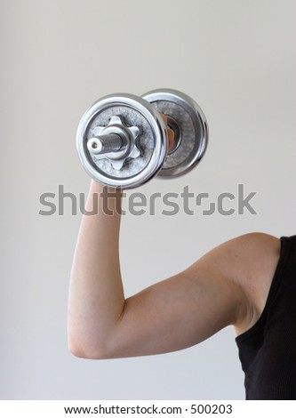 Lifting hand weight - stock photo
