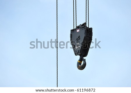 Lifting Hook Of A Heavy Crane Against Blue Sky - stock photo