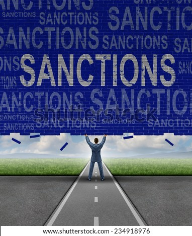 Lifting Sanctions as a global economic symbol for solutions to trade disputes as a man removing a brick wall with words as a metaphor for diplomatic success in negotiating government agreements. - stock photo