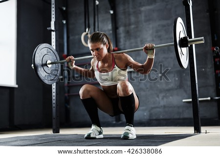 Lifting weight in gym - stock photo