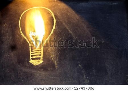 lighbulb design on blackboard, metaphor of innovation - stock photo