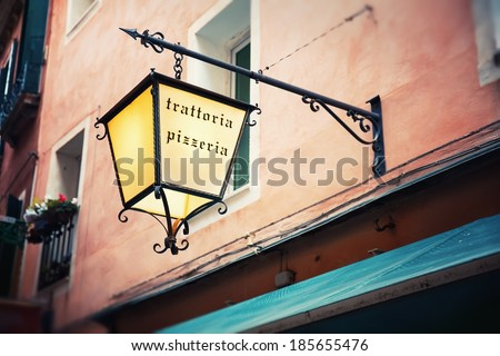 Light advertising on pizzeria - pubs in Italy in Venice - stock photo
