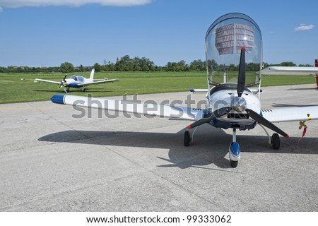 Light aircraft parked with opened canopy - stock photo