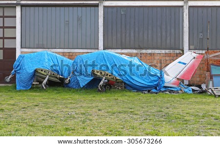 Light Aircrafts Grounded and Covered With Tarp - stock photo
