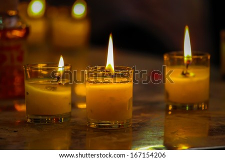 Light and Candles at thai temple - stock photo