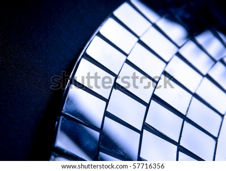 Light and shadow across glass squares in circular patterns