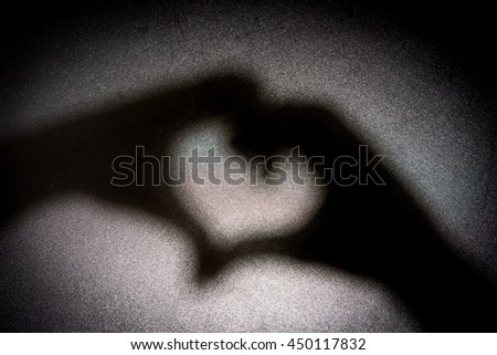 Light and Shadow hands Symbols of love. - stock photo